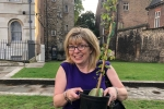 Maria Caulfield MP is pictured with a beech tree sapling